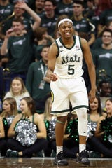 Jan 29, 2020; East Lansing, Michigan, USA;  Michigan State Spartans guard Cassius Winston (5) reacts after a made three point basket during the second half against the Northwestern Wildcats at the Breslin Center. Mandatory Credit: Mike Carter-USA TODAY Sports