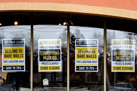 Signs alert customers of store closing sales hang in the windows at the Klingman's Furniture and Design store at 6025 W. Saginaw Hwy, in Lansing, on Thursday, Jan. 30, 2020.
