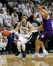 Michigan State guard Kyle Ahrens played just eight minutes Wednesday against Northwestern, but the Spartans were 13 points better with him in the game.