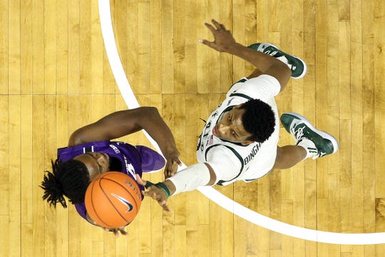 Jan 29, 2020; East Lansing, Michigan, USA;  Northwestern Wildcats forward Jared Jones (4) has his shot blocked by Michigan State Spartans forward Marcus Bingham Jr. (30) during the second half at the Breslin Center. Mandatory Credit: Mike Carter-USA TODAY Sports