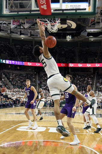 Jan 29, 2020; East Lansing, Michigan, USA; Michigan State Spartans forward Malik Hall (25) dunks the ball against the Northwestern Wildcats during the first  half a game at the Breslin Center. Mandatory Credit: Mike Carter-USA TODAY Sports