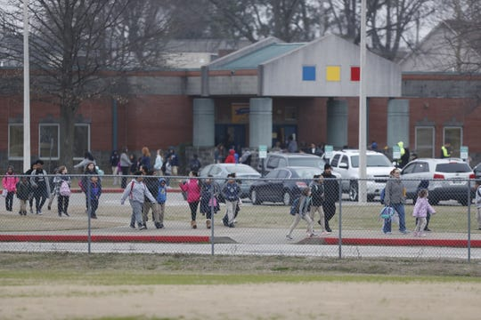 The scene outside Kate Bond Middle School in Memphis on Thursday, Jan. 30, 2020 where students were evacuated due to a potential carbon monoxide leak that sickened several students.
