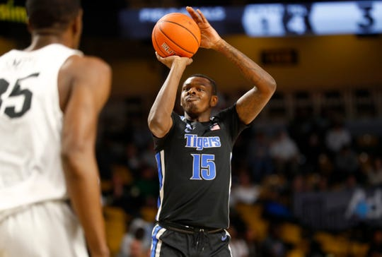 Memphis Tigers forward Lance Thomas shoots the ball against the UCF Knights during their game at the Addition Financial Arena on Wednesday, Jan. 29, 2020.