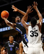 Memphis Tigers forward Precious Achiuwa shoots the ball over UCF Knights forward Collin Smith during their game at the Addition Financial Arena on Wednesday, Jan. 29, 2020.