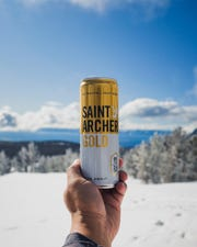 MillerCoors offers to give Michelob Ultra fans a free six-pack of Saint Archer Gold.
