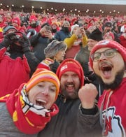 Chiefs fans Bob Larsen, from left, Tim Swartz and Adrian Love cheer at the AFC championship game Jan. 19 in Kansas City.
