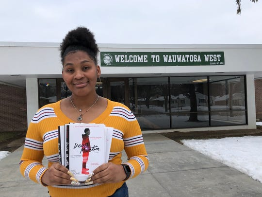 "Jalah Bates, a senior at Wauwatosa West High School, holds up the book ""Dear Martin,"" which was read by students who took the newly offered Black Literature course there."