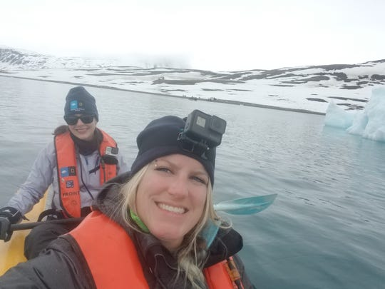 Julie Theim (foreground), an art teacher at Rolling Hills Elementary School in Mukwonago, and shipmate Melissa Cook are shown kayaking near Svalbard, a Norwegian archipelago halfway between Norway and the North Pole. Theim went on the trip in 2018 as part of a Grosvenor Teacher Fellowship, a professional development opportunity for educators made possible by a partnership between Lindblad Expeditions and the National Geographic Society.
