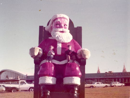 Kids enjoy the giant Santa in Normandale in the early 1970s.