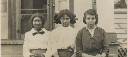 Three female students enrolled at Alabama State University in 1900.