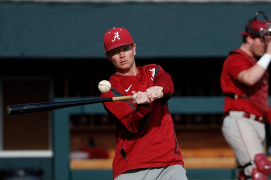 Alabama head baseball coach Brad Bohannon hits grounders to his team during a recent preseason practice Jan. 24, 2020 inside Sewell-Thomas Stadium in Tuscaloosa. (Photo by Jeff Hanson/Alabama athletics)