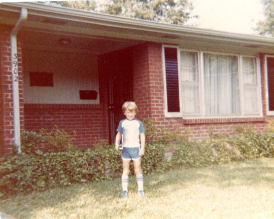The author at age 5 in front of the Normandale home.