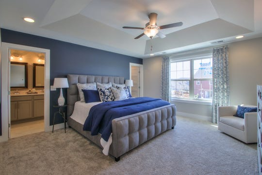 This bedroom in a Goodall model home in Durham Farms shows how elements from the design studio come together.