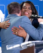 "Predators President and CEO Sean Henry and Tennessee State University President Glenda Glover embrace after they announce their ""$1 Million in One Month"" campaign Thursday."