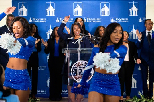 "TSU cheerleaders lead a chant with TSU President Glenda Glover (center) after they announce their ""$1 Million in One Month"" campaign Thursday."