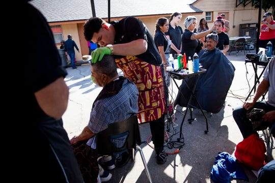 Students from Immokalee Technical College's iSalon give free haircuts during the annual homeless count at Our Lady of Guadalupe Catholic Church in Immokalee on Thursday, January 30, 2020.