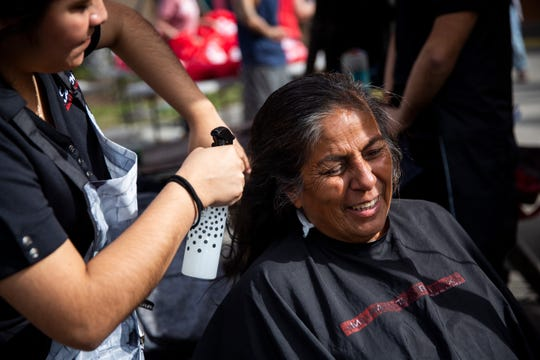 Jesusita Rodriquez gets her hair cut during the annual homeless count at Our Lady of Guadalupe Catholic Church in Immokalee on Thursday, January 30, 2020. Students from Immokalee Technical College's iSalon offered their services for free.