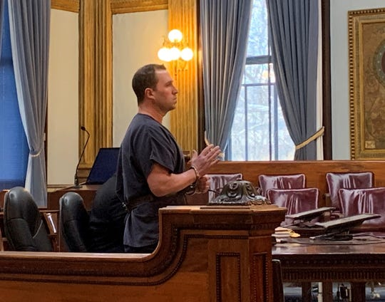 Nicholas Huffman raises his hand to be placed under oath for a change of plea and sentencing hearing in Licking County Common Pleas Court on Thursday, Jan. 30, 2020. Huffman pleaded guilty to felonious assault and abduction, resulting in a six to eight year prison sentence.