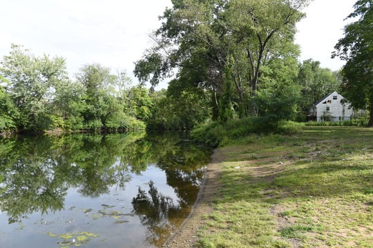 The view facing south of the Ramapo River from the Riveredge Drive in Pompton Lakes.