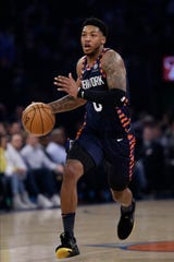 New York Knicks' Elfrid Payton (6) looks to pass the ball during the first half of the team's NBA basketball game against the Memphis Grizzlies on Wednesday, Jan. 29, 2020, in New York.
