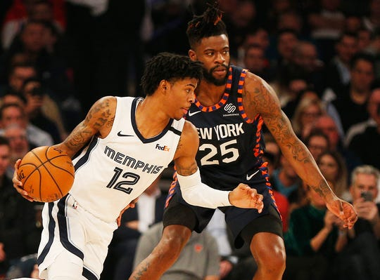 Jan 29, 2020; New York, New York, USA; Memphis Grizzlies guard Ja Morant (12) dribbles the ball against New York Knicks guard Reggie Bullock (25) during the first half at Madison Square Garden.