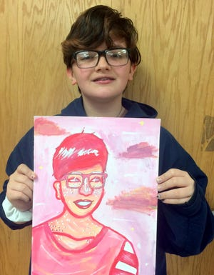 """Autyana """"Toby"""" Bollier shows her Fauve self-portrait at Red Mountain Middle School."""