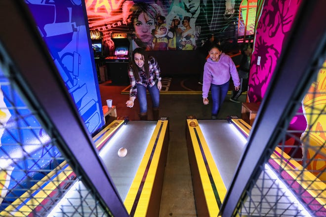 Shelby Castello and Raquel Torres with Big Brothers, Big Sisters Play Skee Ball at Rad Retrocade in Downtown in Las Cruces to celebrate National Mentoring Month on Wednesday, Jan. 29, 2020.