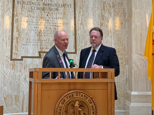 From left, Spaceport America executive director Dan Hicks with John Tysseling of Moss Adams at a press conference at the New Mexico state capitol in Santa Fe. Thursday, Jan. 30, 2020.