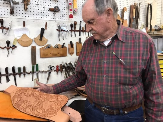 Silver City-area saddler John Andrews with his tools and leatherwork. Andrews Custom Saddles will be donating materials for a leather workshop Saturday, Feb.1 at the Silver City Museum Annex.