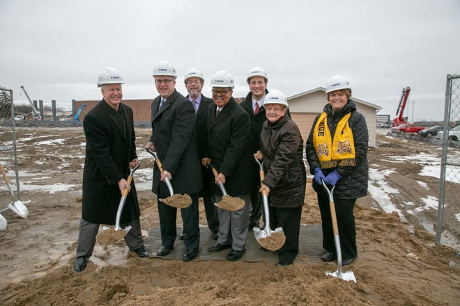 The Schoolcraft College Board of Trustees celebrates the groundbreaking for the new St. Joe's Mercy Elite Sports Center on Monday, January, 27, 2020. Pictured from left to right are: Terry Gilligan, Treasurer; Brian D. Broderick, Chair; William P. Erwin, Jr., Trustee; Dr. Conway A. Jeffress, President; Dillon E. Breen, Trustee; Carol M. Strom, Vice Chair; and Joan A. Gebhardt, Secretary.