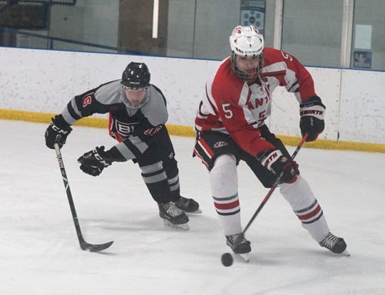 Canton High's Hugo Fonovic comes around the boards with the puck.
