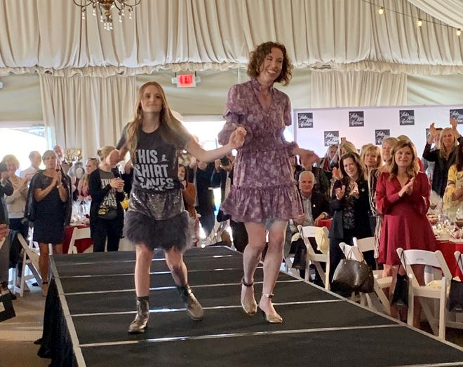 Cancer survivor Natalie Tanner rocks the runway on Jan. 24 at Toscana Country Club.