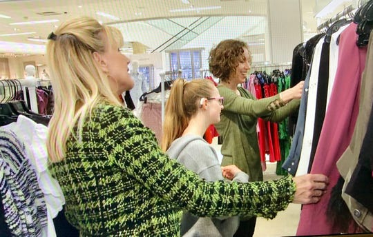 Sandie Newton helps select wardrobe for the fashion show.