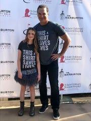 Natalie Tanner poses with actor Patrick Warburton.
