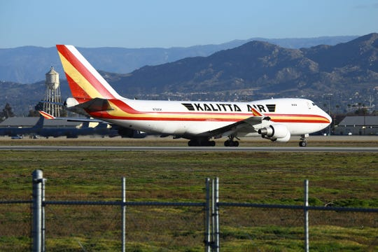 A charter plane lands at March Air Reserve Base in Riverside, California on January 29, 2020, with passengers evacuated from Wuhan, the Chinese city at the heart of a growing outbreak of the deadly 2019 Novel Coronavirus. - Some 200 US citizens evacuated from Wuhan were met on the tarmac by emergency vehicles and three buses. The Department of Defense said the evacuees will be sent to local hospitals if they are suspected of being infected with the 2019 Novel Coronavirus. The epidemic has killed more than 130 people and spread around the world since it first emerged in a live food market in Wuhan in December.
