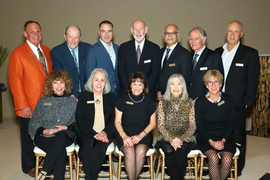 JFS board secretary Lee Erwin, back row, 3rd from left, will be honored with the JFS Humanitarian Award on Sunday, March 15.