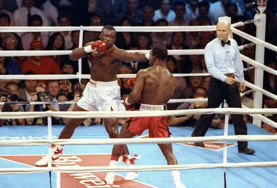 James (Buster) Douglas (left) trades blows with Evander Holyfield during a World Heavyweight title bout.