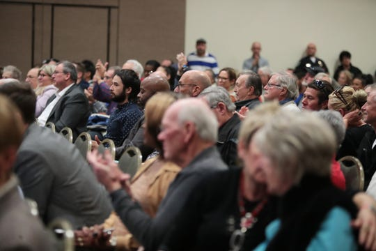 People applaud during the City of Palm Springs' first public hearing to discuss and hear community feedback about how the one-time $10 million allocation from the state should be used to address homelessness in Palm Springs, Calif., on January 29, 2020.
