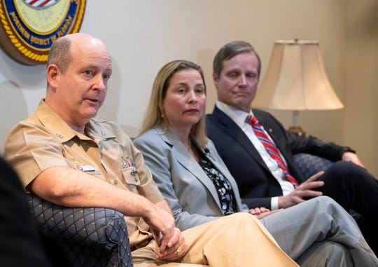 NAS Pensacola Commanding Officer Capt. Tim Kinsella joins FBI Special Agent Rachel Rojas and U.S. Attorney Larry Keefe for a press conference on Thursday, Jan. 30, 2020.