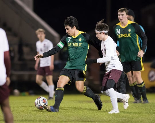 Tyler Ryals (7) controls the ball during the Tate vs Catholic boys soccer game at Pensacola Catholic High School in Pensacola on Wednesday, Jan. 29, 2020.