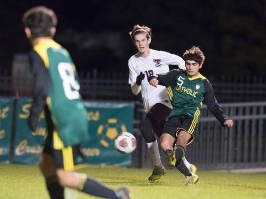 Darren Bredesen (5) passes the ball during the Tate vs Catholic boys soccer game at Pensacola Catholic High School in Pensacola on Wednesday, Jan. 29, 2020.