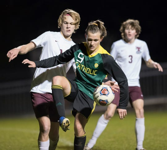 Miller Thorsen (9) controls the ball during the Tate vs Catholic boys soccer game at Pensacola Catholic High School in Pensacola on Wednesday, Jan. 29, 2020.