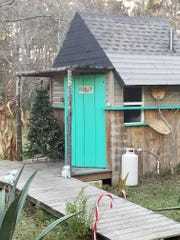 A cabin rests the property of Joseph Roadcap in Garcon Pointe, which serves as an Airbnb facility. Now, he can no longer use much of the facility after a failed rezoning request.