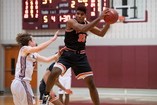 York Suburban's Anthony Brown leaps in the air to catch a pass late in the second quarter against Gettysburg on Wed., Jan. 29, 2020.