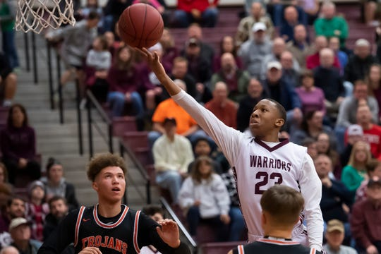 Gettysburg's Quadir Copeland floats through the air to score on a layup and put the Warriors up 24-21 in the second quarter against York Suburban on Wed., Jan. 29, 2020.
