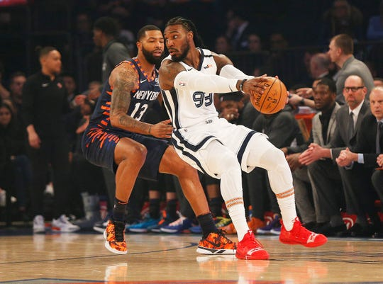 Memphis Grizzlies forward Jae Crowder (99) dribbles the ball against New York Knicks forward Marcus Morris Sr. (13) during the first half at Madison Square Garden on Jan. 29, 2020.