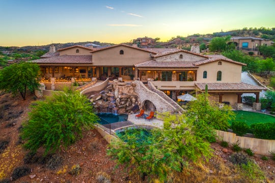 Tom and Jane Kadlec paid $3.1 million for a golf course lot estate at the Firerock community in Fountain Hills