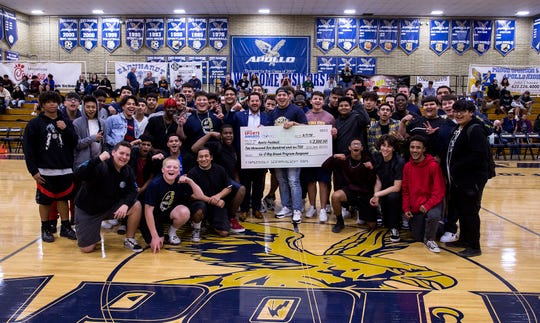 During halftime of the Apollo/Sunnyslope varsity basketball game on Jan. 28, 2010, the Apollo High School's football team shows off a check of $2,500 received from the La-Z-Boy Grant Program in connection with the azcentral Sports Awards.