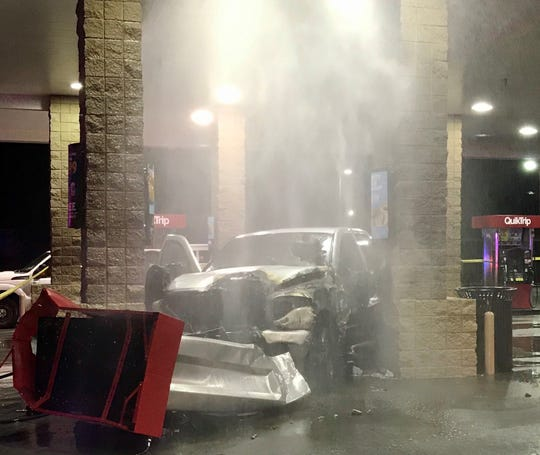 The car that crashed into a Mesa QuikTrip gas station and caught on fire with the puppies inside on Jan. 29, 2020.