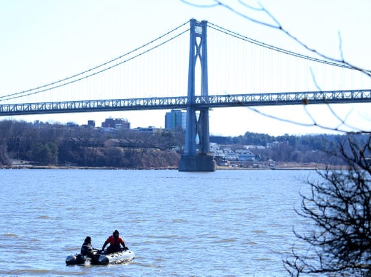 New York State Police Divers Search the Hudson River under the Walkway Over The Hudson State Park in Highland on January 29, 2020.